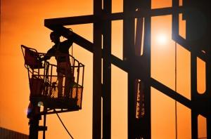 Welder working on steel structure